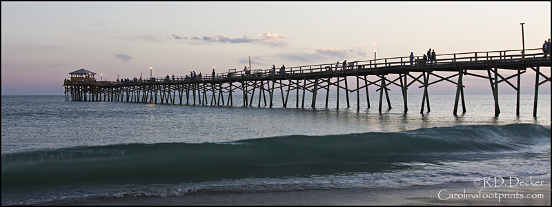 The Oceanana Fishing Pier Juts Out Into Ocean Along Atlantic Beach In North Carolina